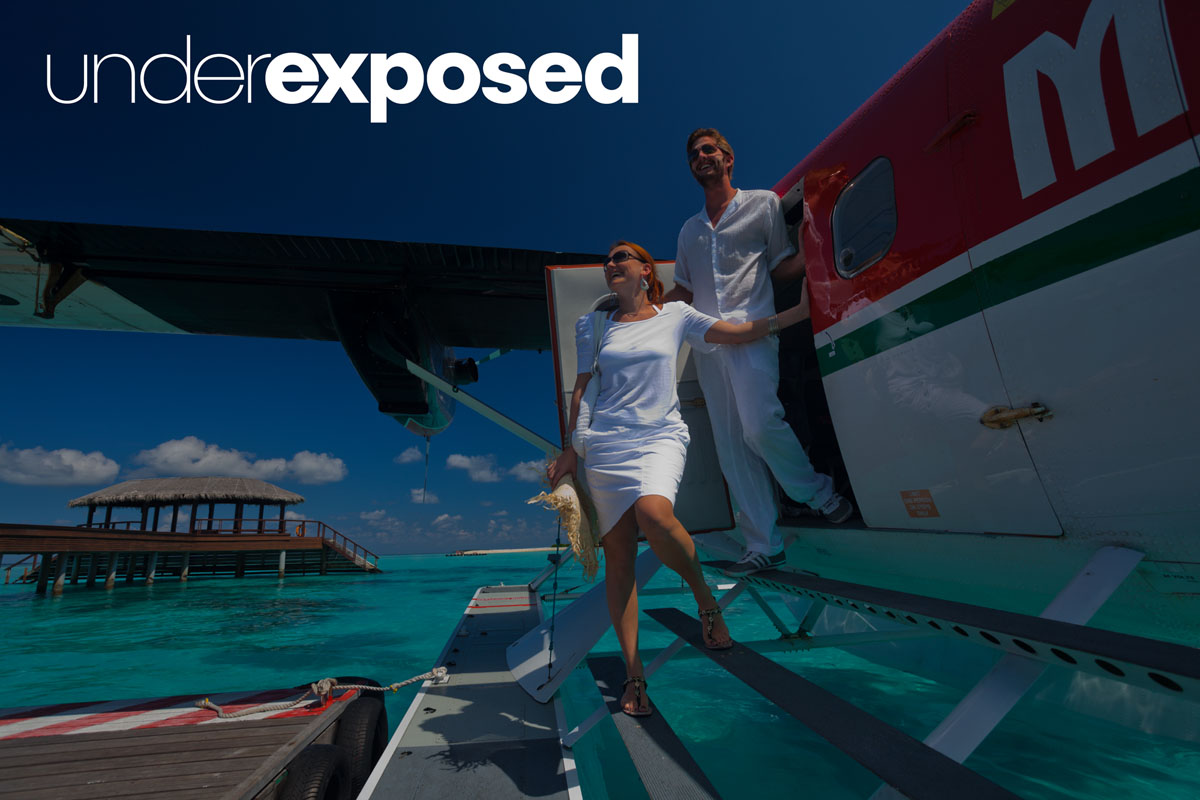 underexposed image of couple exiting seaplane